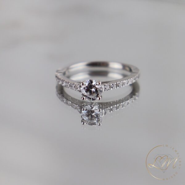 Four Claw Round Diamond Engagement Ring